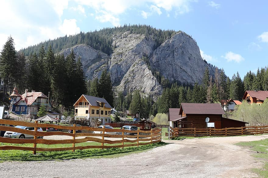 cabin guest house stones rocks hiking mountains hostel traditional romania