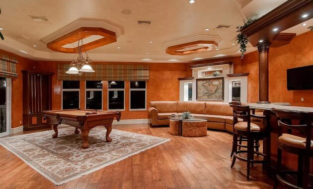 rec room living room recreation pool table bar couch home indoors leisure