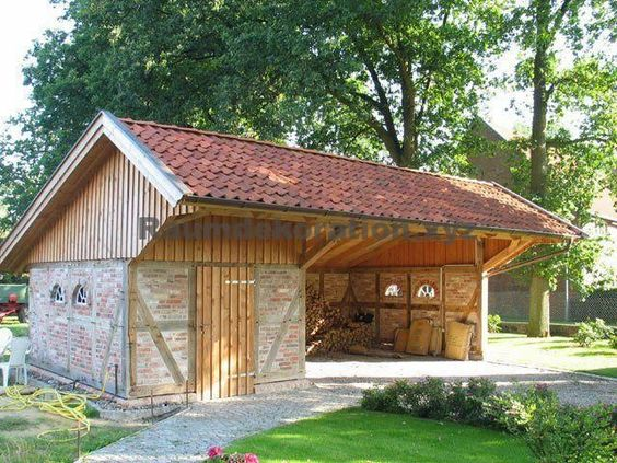 wooden garage with brick decor
