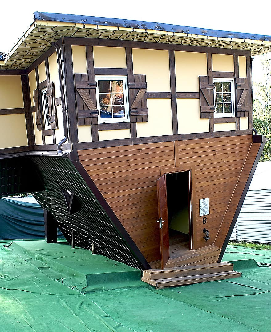 cottage upside down house architecture a joke inverted house small building the window the door wooden cottage