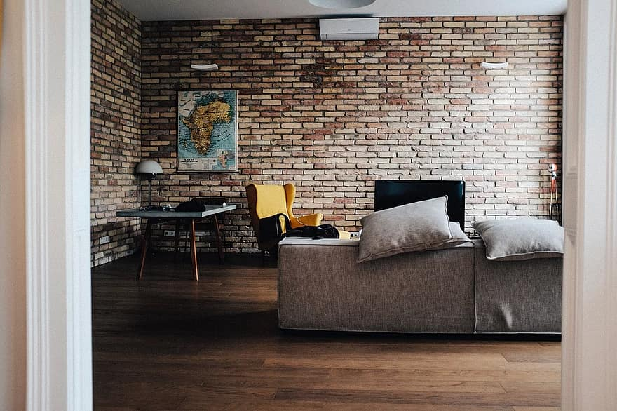 house interior couch sofa living room brick