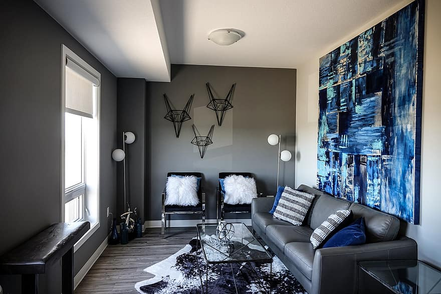 living room blue blue painting painting wall decor abstract art abstract wall hangings grey couch grey