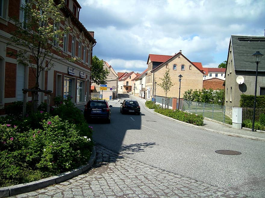 road asphalt road houses facades building vehicles small town bad lauchstadt