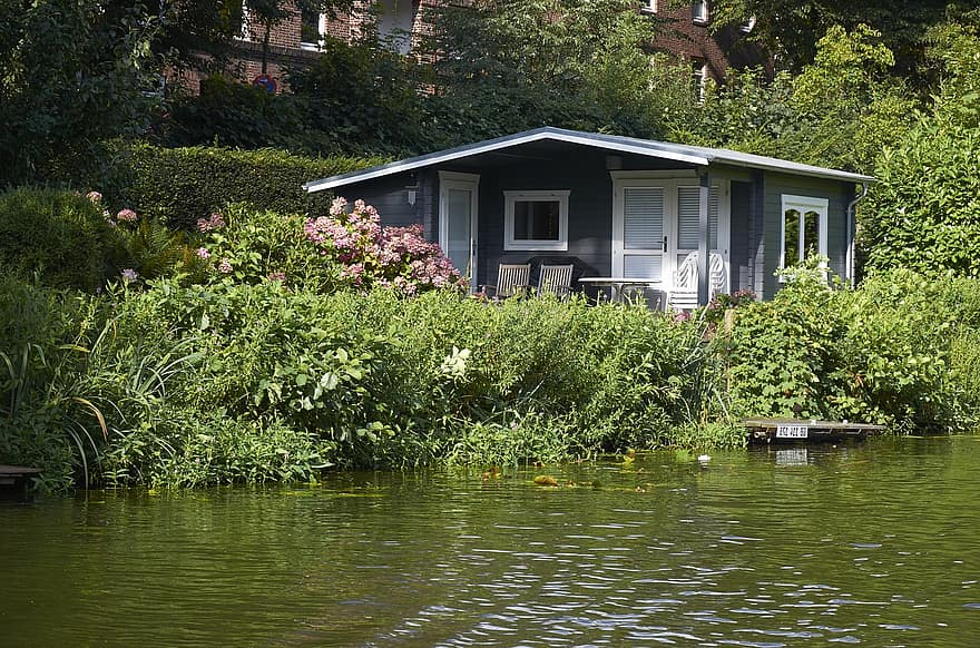 small house water s edge green nature lake based
