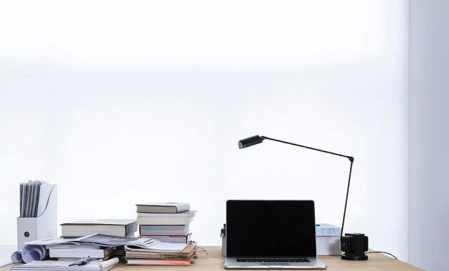 laptop computer browser research business work desk table lamp