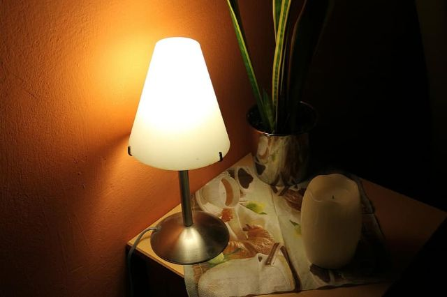 bedside table night table lamp lamp light lighting ambience atmosphere shining