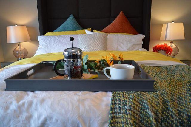 breakfast in bed bed bedroom tray coffee breakfast lamp bedside pillows