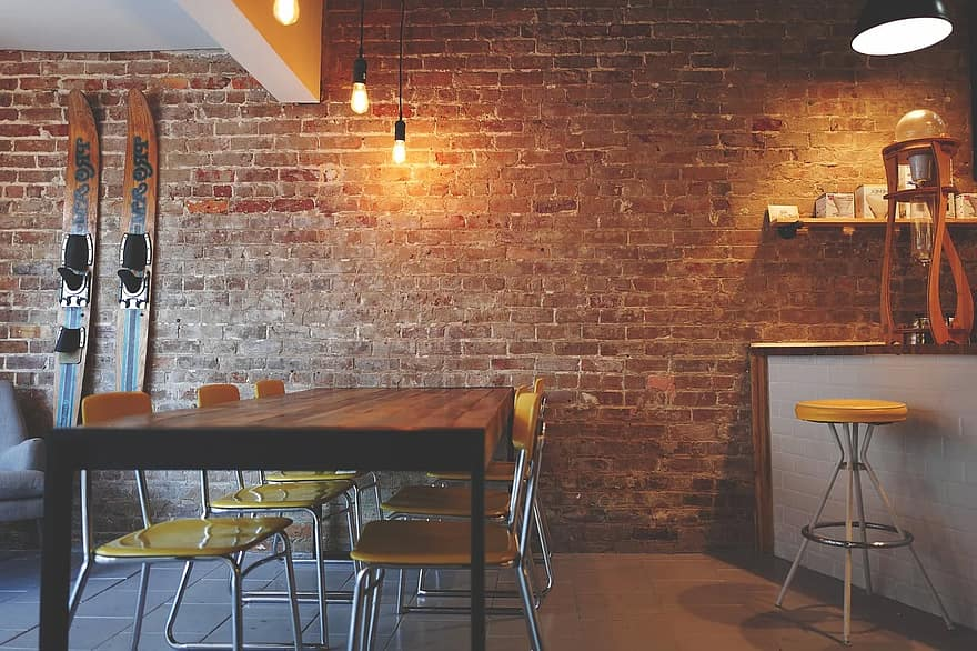 brick wall chairs furniture interior design lights restaurant table rustic