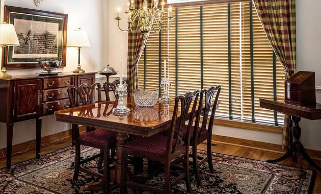 dining room table chairs sideboard buffet window blinds rug carpet