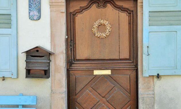 door wooden door carved door alsace house alsatian house windows village france