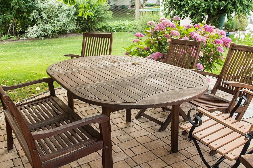 garden garden furniture sit table garden chairs idyllic flowers relaxation resting place