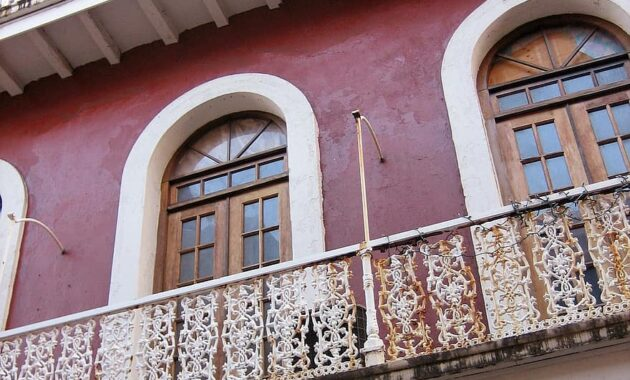 puerto rico building porches old building red architecture railing facade arches windows