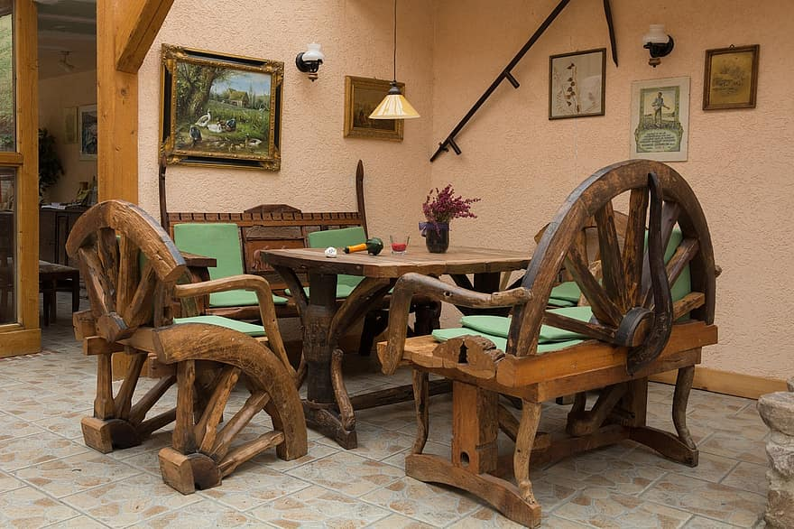 seating area rustic rural restaurant table bank chair covered quaint