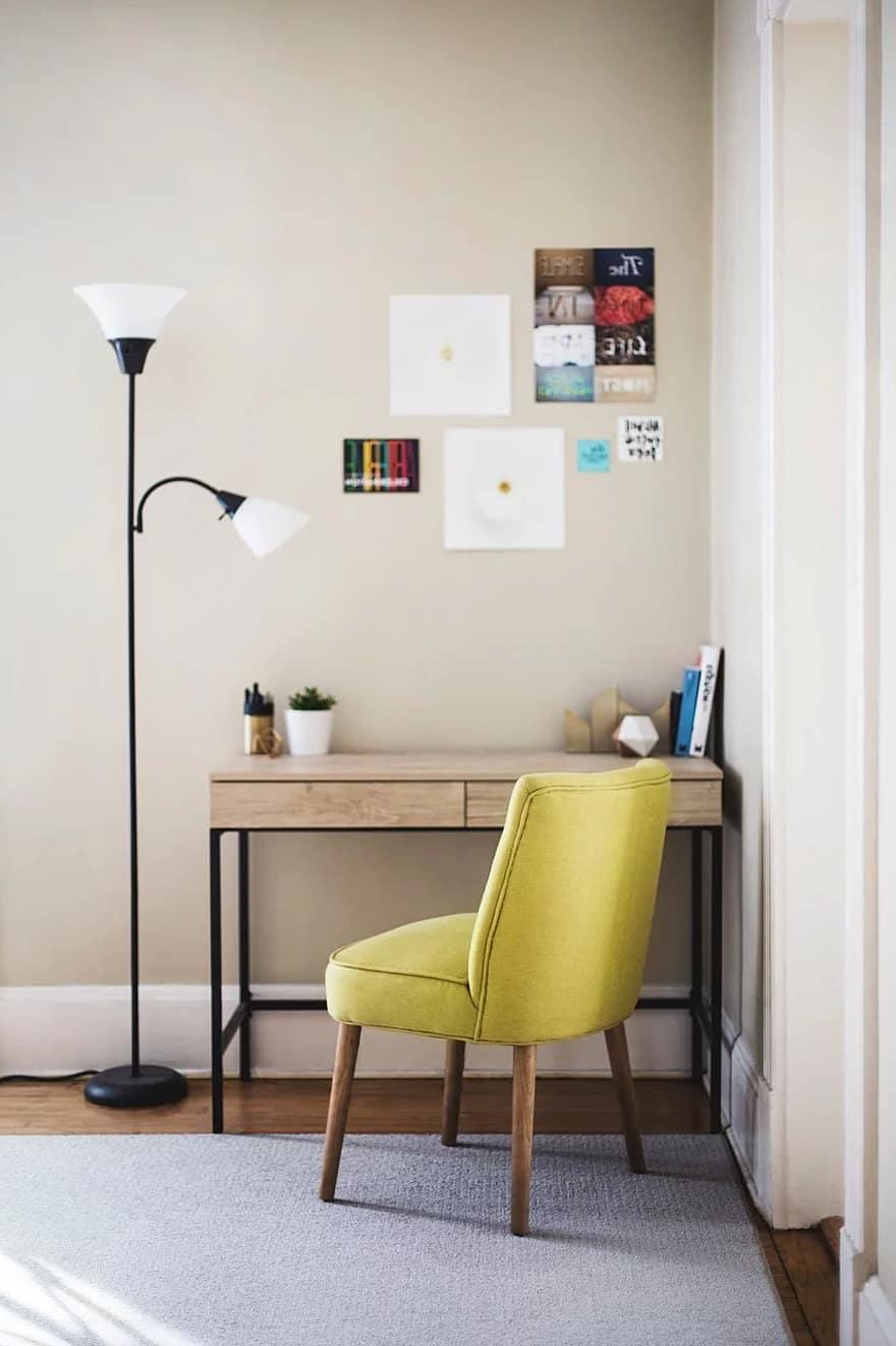 table chair desk lamp room carpet books pens posters