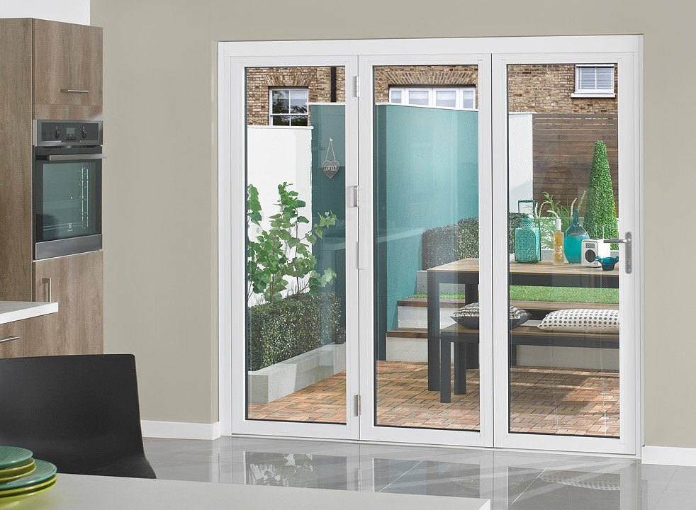 white aluminum triple doors