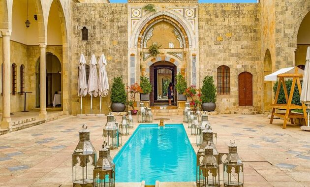 palace oriental pool swimming pool patio arcades arches architecture ancient