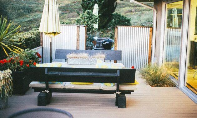 patio backyard umbrella bench table wood deck plants