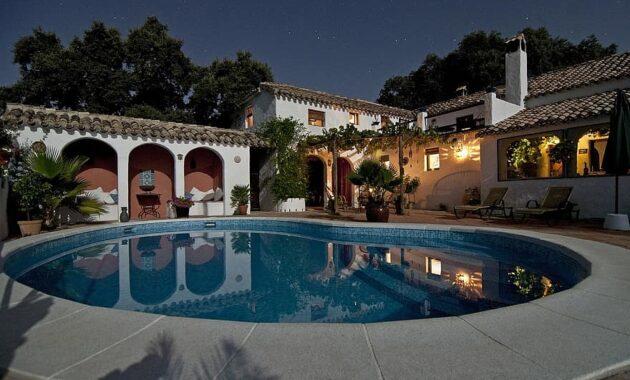 pool backyard villa house arches roof rich stars night