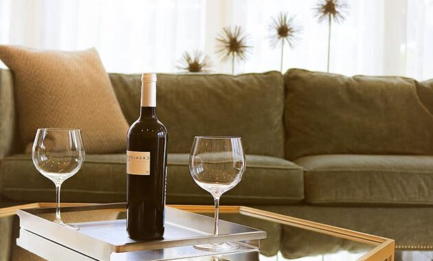 cozy furniture indoors sofa stemware table wine