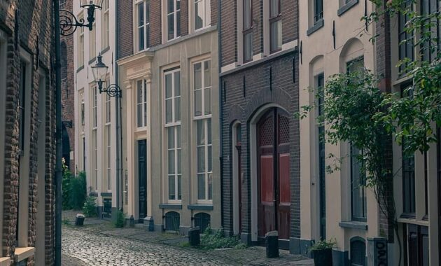 city street building architecture facade pavers street scene historical house