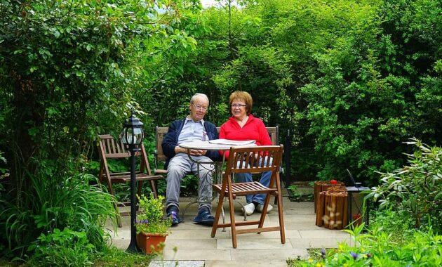 couple man woman sit rest garden terrace chair table