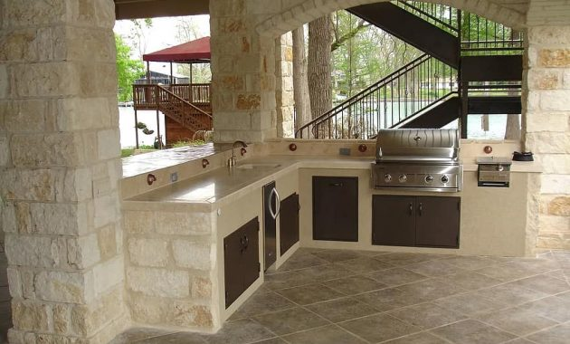 outdoor kitchen stone masonry copper cooking outdoor kitchen wood fireplace
