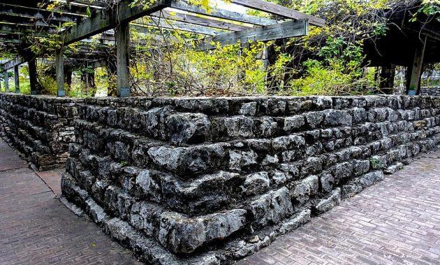 stone stone wall vines brick brick walkway plants garden nature green