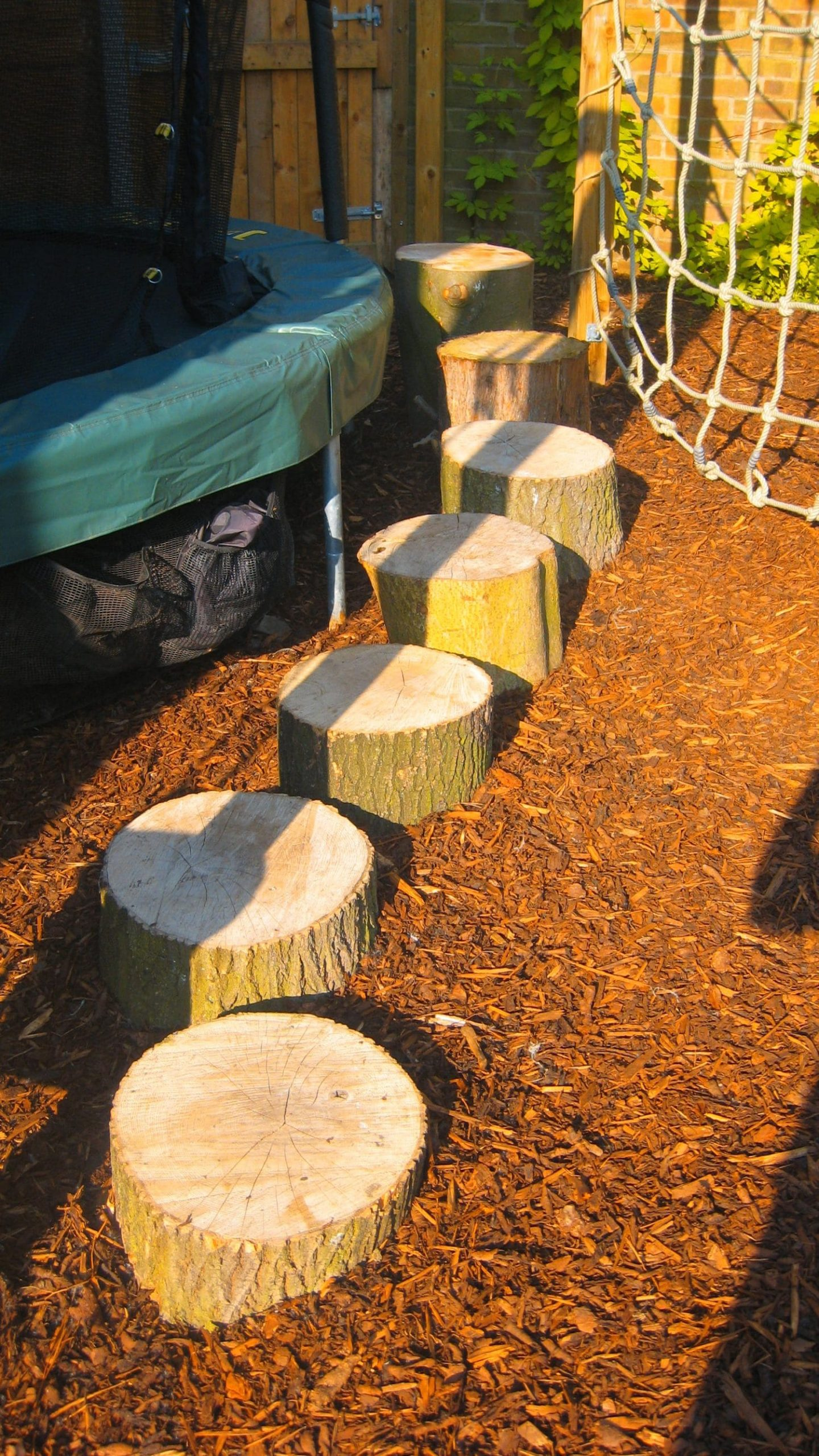 mini playground with tree stump ideas