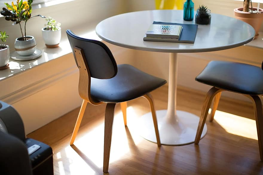Round table with two wooden chairs