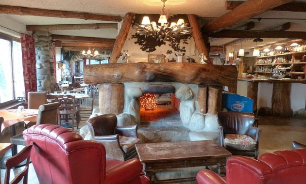 dining room restaurant living room space cozy fire fireplace open fireplace guest room