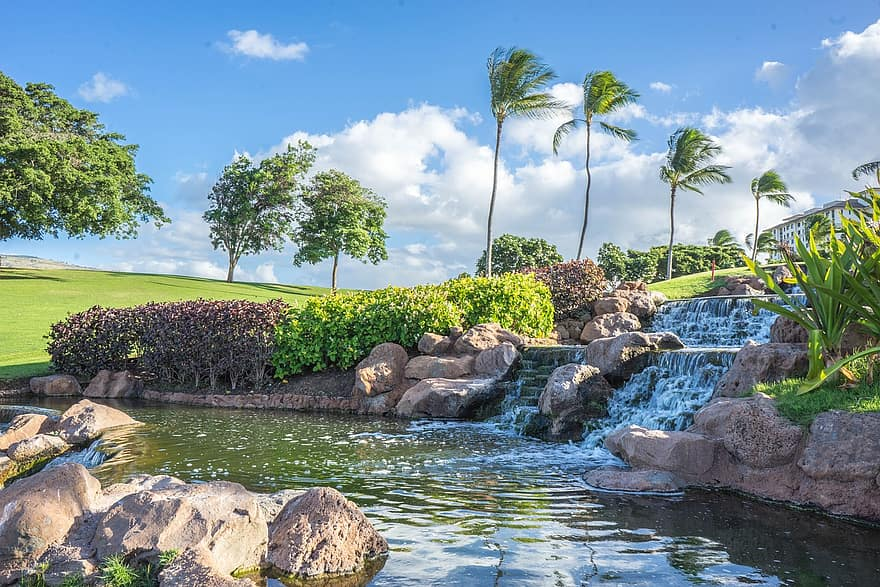 hawaii oahu waterfall rocks ko olina pond palm trees water landscape