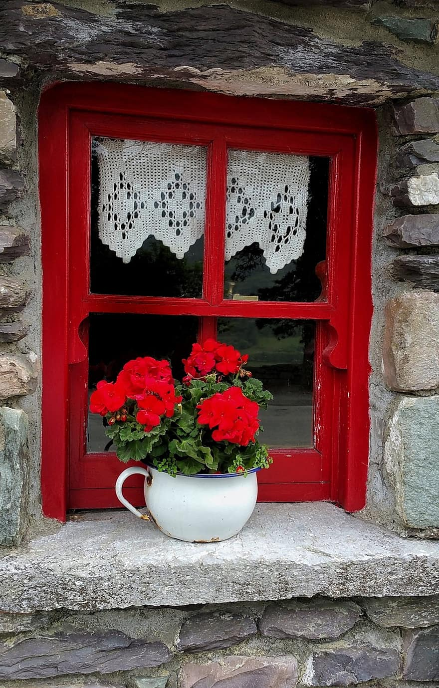 old irish cottage window planter pot flower decoration geranium