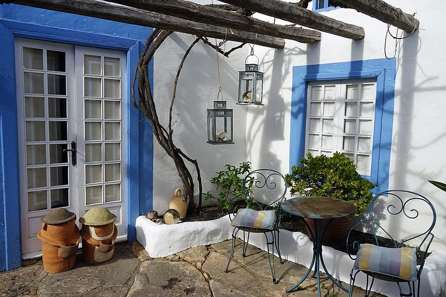 backyard seating area cozy spain rest blue