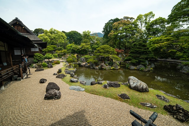 Beautiful house garden with traditional building and rock garden