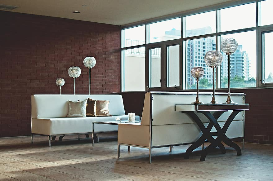 apartment living room brick wall contemporary couch furniture home room indoors