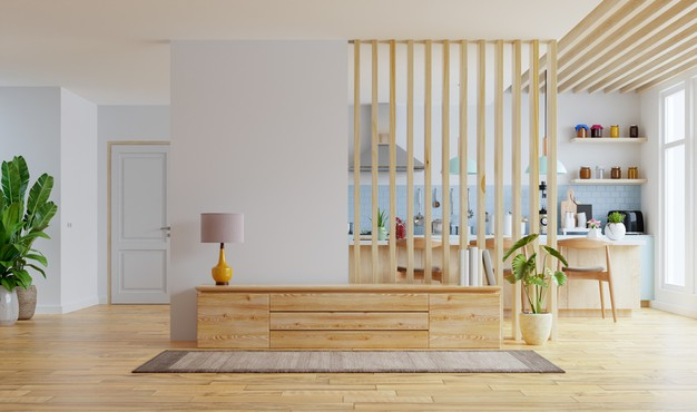 open area kitchen room with hanging wood wall decor