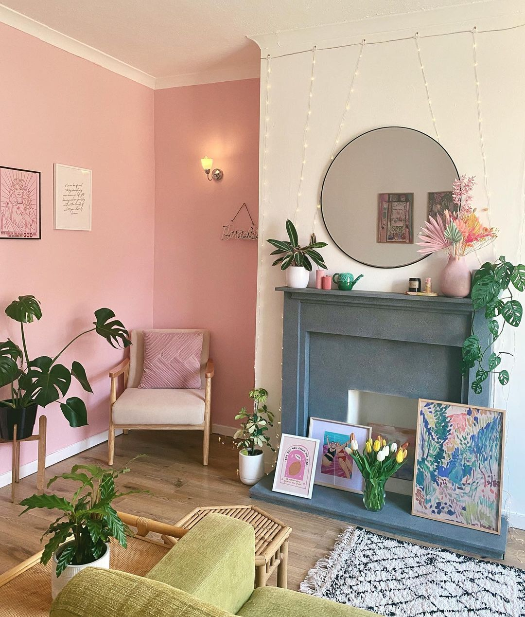 pink living room with wooden furniture