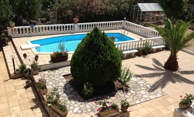 backyard garden swimming pool pool water house blue summer tropical