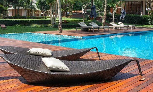 relaxing loungers pool side swimming pool resort thailand luxury vacation summer