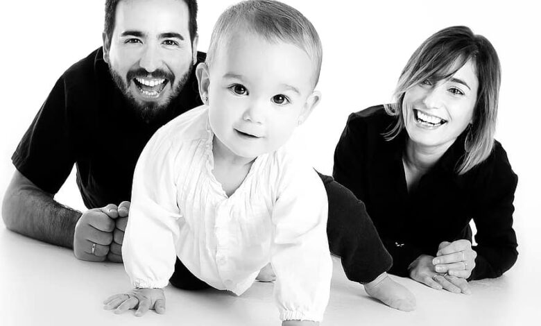 family baby crawling mother smiling happy happy children smile joy