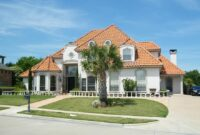 spanish style red brick tiles roof blue sky home house residence palm tree