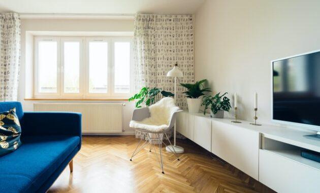 Blue sofa with white furniture